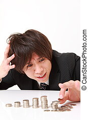 studio shot of young Japanese businessman on white background
