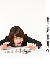 studio shot of young Japanese businesswoman on white background