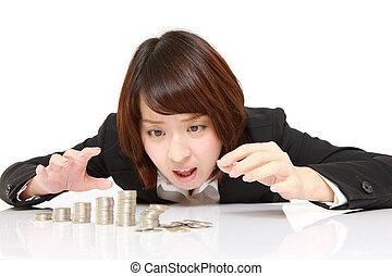 Financial collapse - studio shot of young Japanese ...