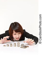 studio shot of young Japanese businesswoman