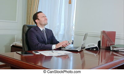 Financial company office young businessman count money cash and waving it