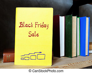Financial concept about Black Friday Sale with phrase on the sheet.