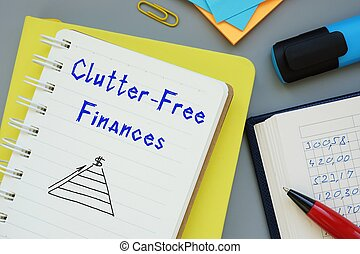 Financial concept about Clutter-Free Finances with sign on the page.