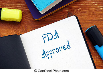 Financial concept about FDA Approved with inscription on the sheet.