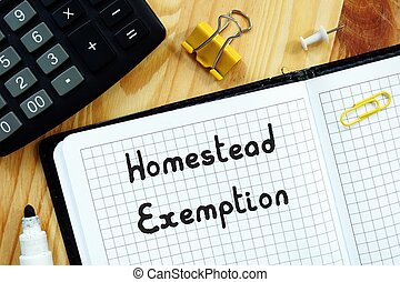 Financial concept about Homestead Exemption with sign on the piece of paper.