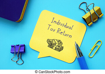 Financial concept about Individual Tax Return with inscription on the piece of paper.