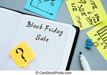 Financial concept meaning Black Friday Sale with inscription on the sheet.