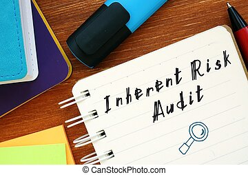 Financial concept meaning inherent risk audit with inscription on the sheet.