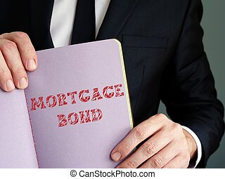 Financial concept meaning Mortgage Bond with inscription on the sheet.