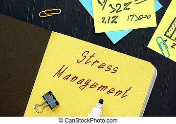 Financial concept meaning Stress Management with sign on the piece of paper.