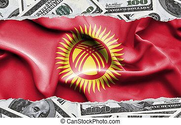 Financial concept with banknotes of US currency around national flag of Kyrgyzstan
