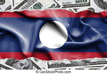 Financial concept with banknotes of US currency around national flag of Laos