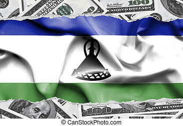 Financial concept with banknotes of US currency around national flag of Lesotho