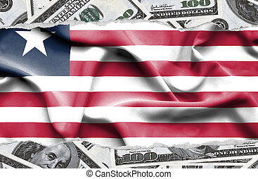 Financial concept with banknotes of US currency around national flag of Liberia