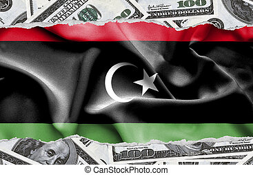 Financial concept with banknotes of US currency around national flag of Libya