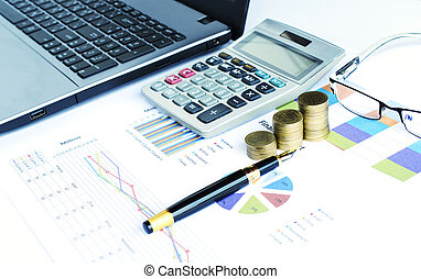 Financial concept with coins stack and calculator and fountain pen and eyeglasses and labtop on document chart data backgrounds