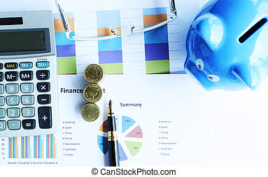 Financial concept with money coins stack and business fountain pen and calculator and eyeglasses and blue piggy bank labtop with document chart on desk office backgrounds above