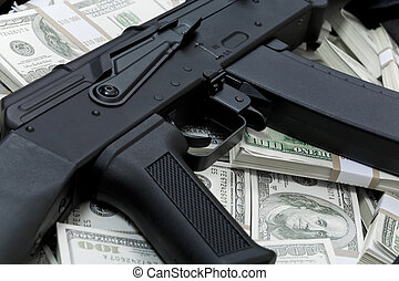 Financial crime - Close-up of black weapon lying on heap of ...