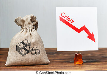Financial crisis concept. A bag of money next to a falling chart
