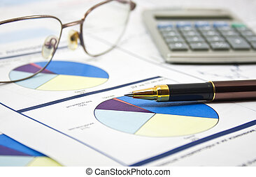 financial data concept with pen and glasses