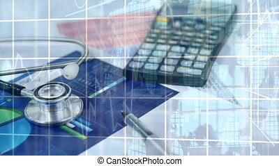 Financial data processing against calculator and stethoscope...