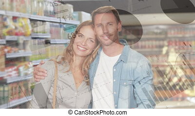 Animation of happy couple embracing, shopping in grocery store with financial data processing. Global finance and shopping concept digital composite.