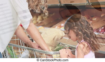 Animation of Caucasian woman with her daughter shopping in grocery store with shopping trolley and financial data processing. Global finance and shopping concept digital composite.