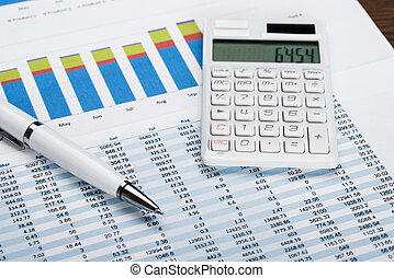 Financial Data Sheet With Calculator And Pen - Close-up Of A...