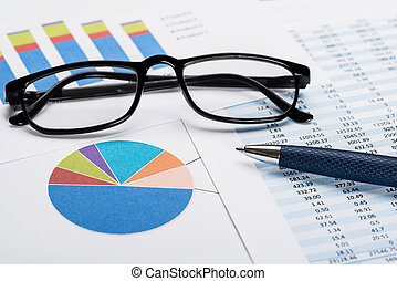 Financial Data Sheet With Eyeglasses And Pen