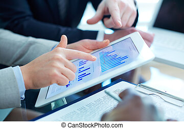 Financial data - Image of human hands during discussion of...