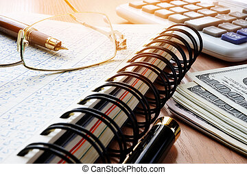 Financial documents and calculator on an office desk. Accounting concept.