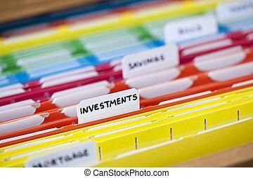 Financial documents in folders - Open file folder drawer...