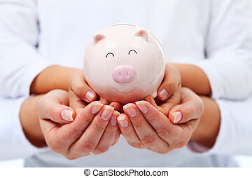 Financial education concept - adult and child hands holding ...