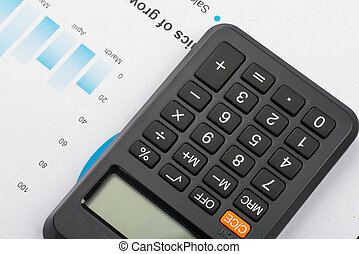 Financial graphs and charts analysis with calculator