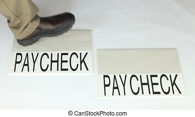 Financial Living - Person stepping from one paycheck to...