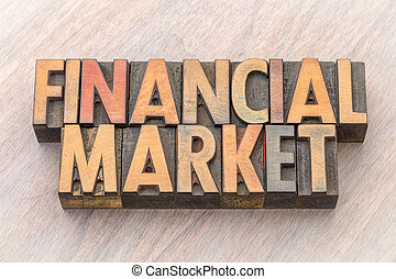 financial market word abstract in wood type