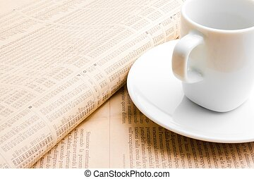 financial newspaper and cup of coffee