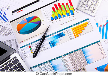 Financial papers on the table - Financial paper charts and...
