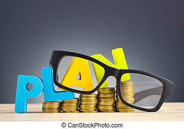 financial planning concept,word PLAN and stacking coins on wooden desk over beautiful reverberation gradient background