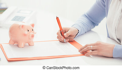 Financial planning - Woman signing a contract and piggy...