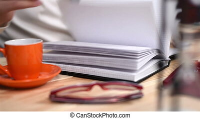 Financial Records In Diary. - Businessman Looking For...