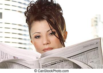Businesswoman reviewing financial markets, stocks, money, business
