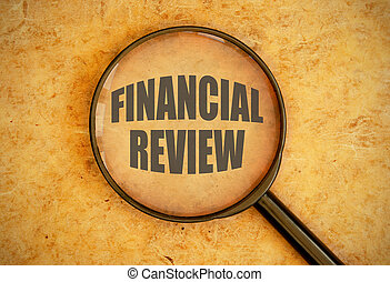 Financial review - Magnifying glass focused on the words...
