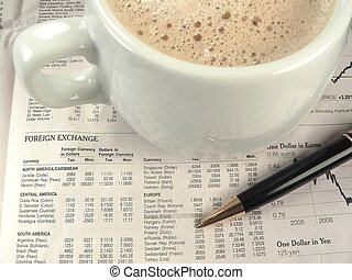 A newspapers financial section with coffee