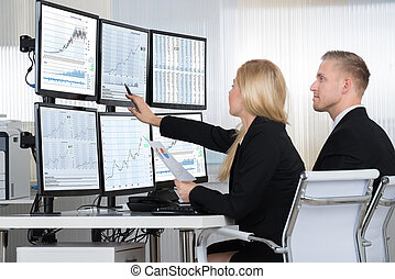 Financial Workers Analyzing Data In Office