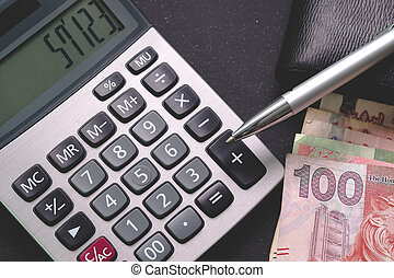 Financial,Banker,Investment, Business concept. Asia bank notes, Calculator on working desk