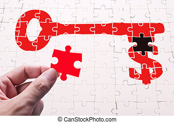 Find key of wealth, human hand and puzzle game.