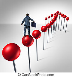 Finding success and planning a strategy to find opportunity as a business man climbing red pushpins in the shape of an upward arrow to financial security..