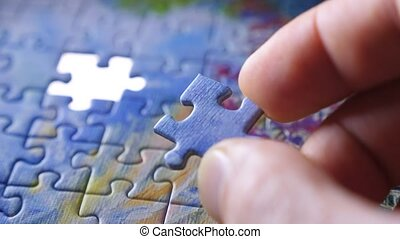 Decision making concept. Finding a solution. Hand matching jigsaw pieces. Jigsaw puzzle assembling. Complex project management. Final exam concept. Completing the project concept. Final result