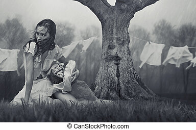 Fine art photo of a young beauty sitting on grass